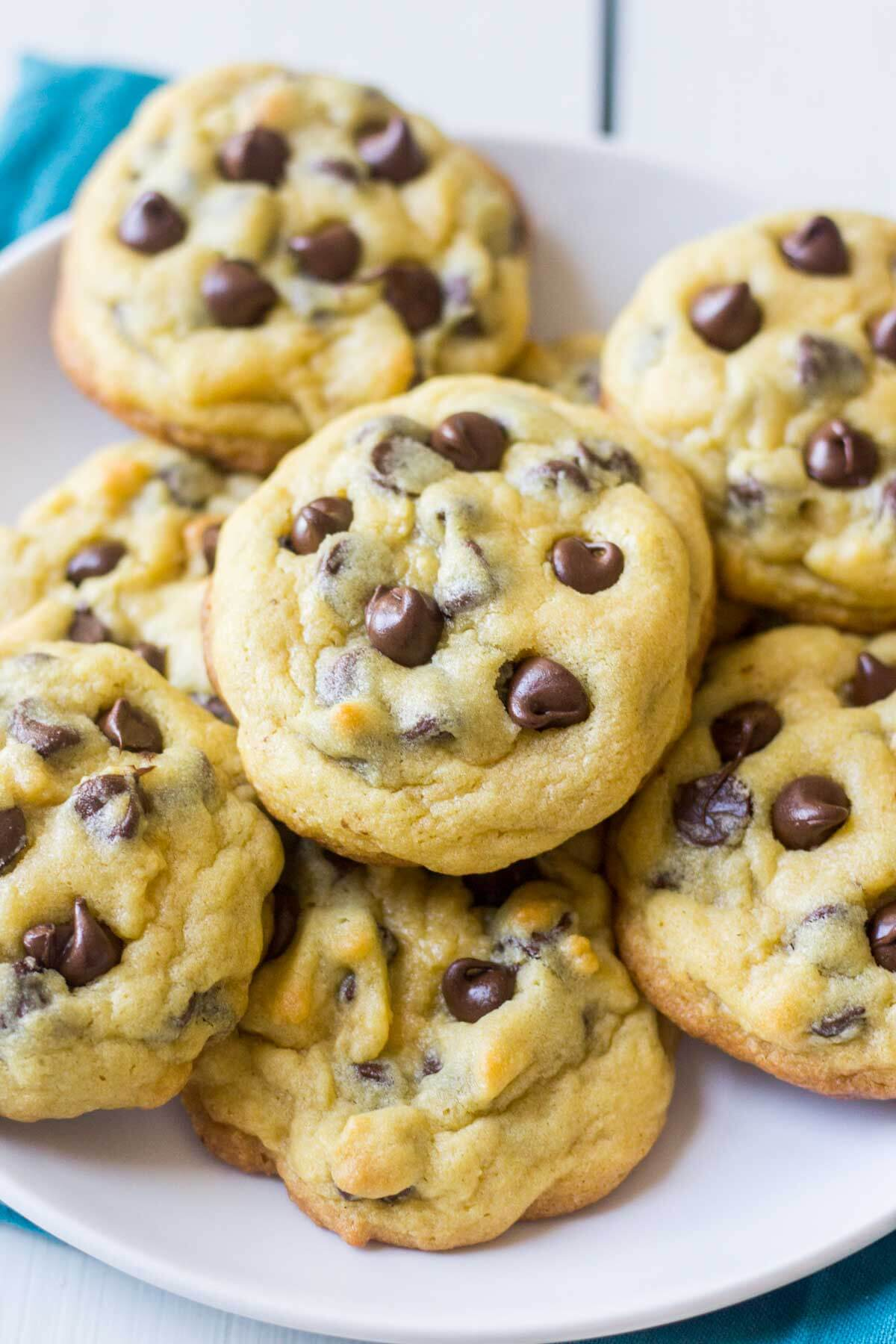 Soft and chewy, these chocolate chip pudding cookies are the best cookie recipe you will ever make! They use the typical cookie ingredients (flour, sugar, butter etc) but they have a secret ingredient: pudding mix. The mix keeps them soft for days and all of the chocolate chip will melt in your mouth. Freeze the cookie dough or baked cookies for months so you have a perfect chocolate chip cookie when you need it!