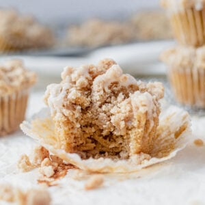 cinnamon coffee cake muffin with a bite taken out