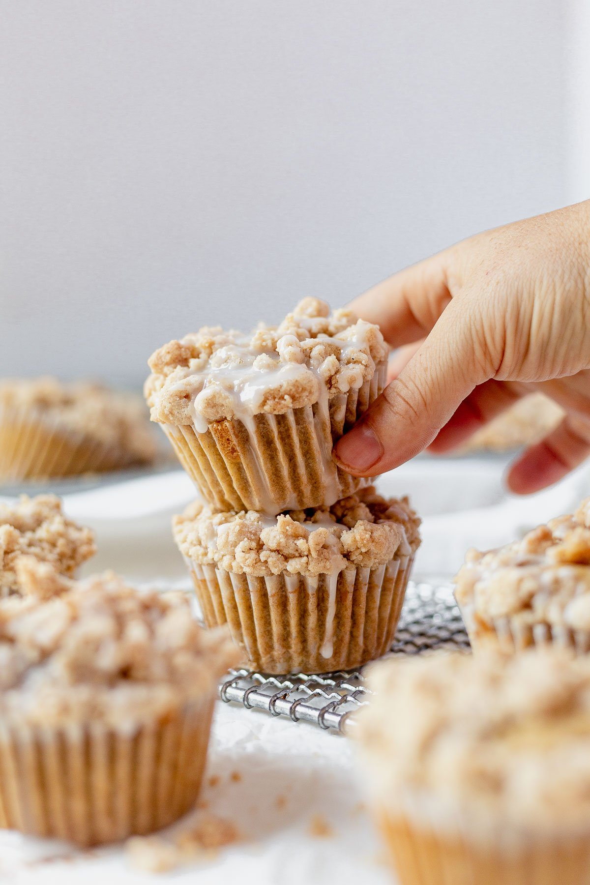 two coffee cake muffins stacked on top of each other with icing dripping down