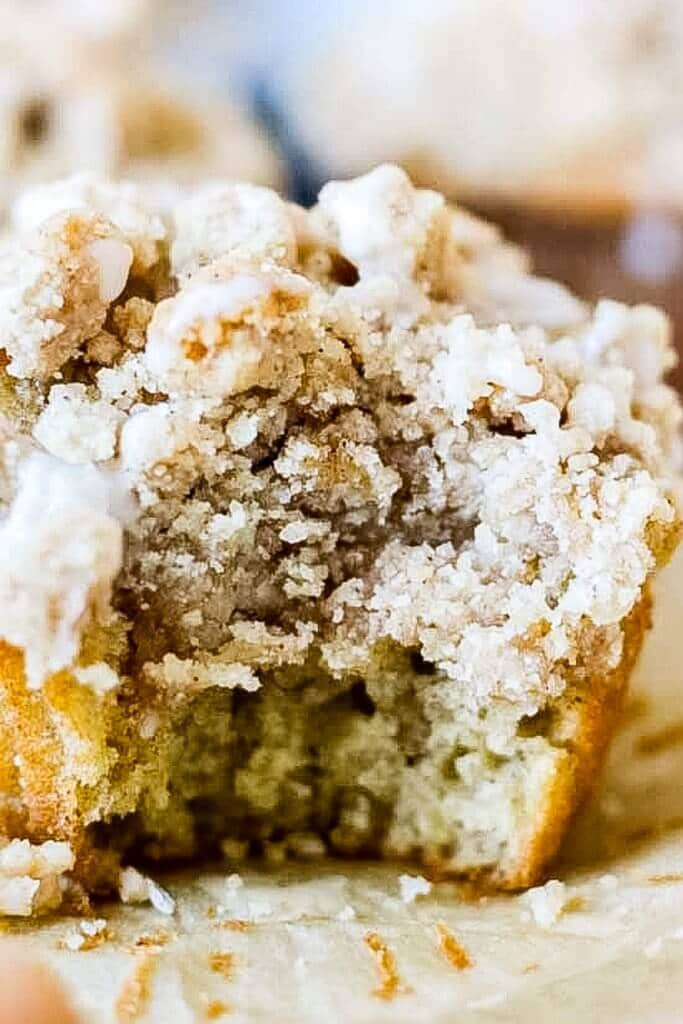coffee cake crumble muffin recipe with a bite taken out of it