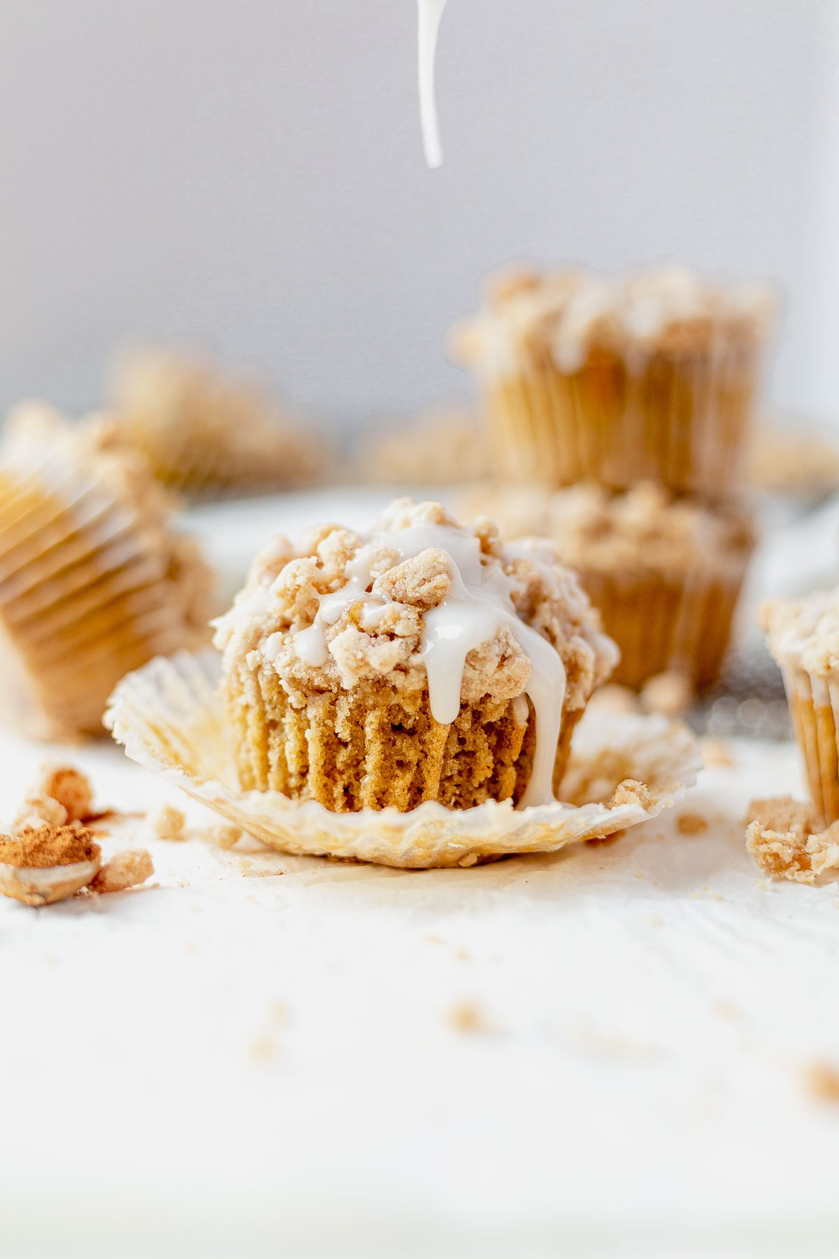 coffee cake muffin unwrapped with icing drizzled on top