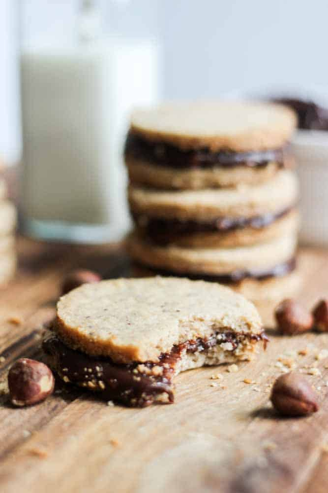 Buttery and filled with chocolate, this Hazelnut Shortbread cookie recipe is the perfect sandwich cookie for Christmas. Nutella desserts are the best and these cookies are filled with Nutella ganache. The hazelnut shortbread is nutty and perfect. Your friends and family (even the kids) will love them!