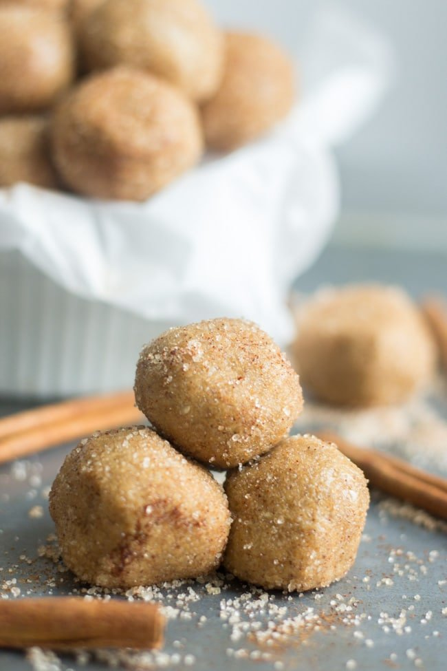 three snickerdoodle protein balls stacked together
