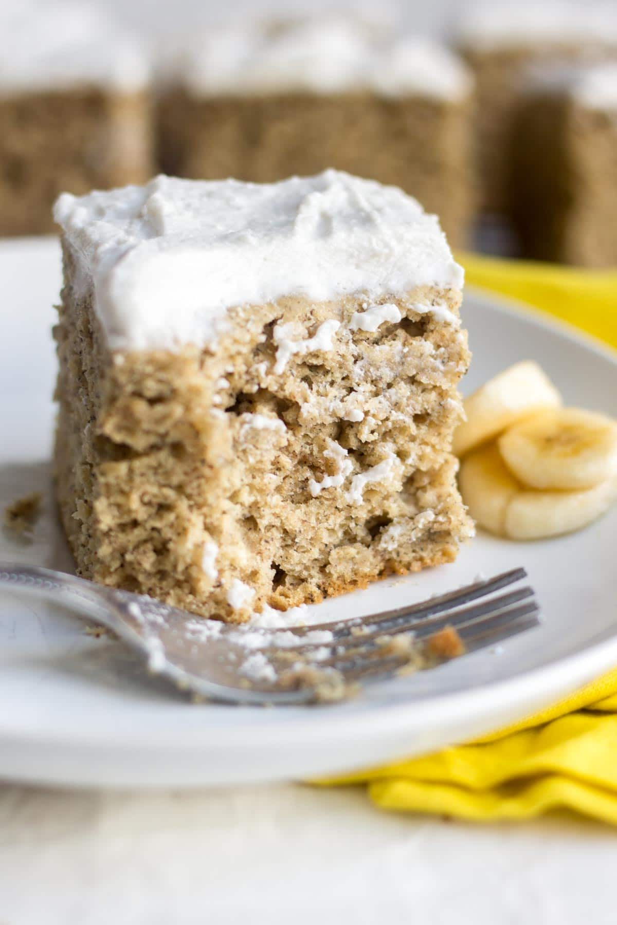 Healthy Banana Cake! You will no believe how easy and healthy is banana cake recipe is. It's oil free and refined sugar free and naturally sweet from the bananas. Top it with vegan coconut whipped cream frosting and your friends will be amazed! So moist and flavorful!