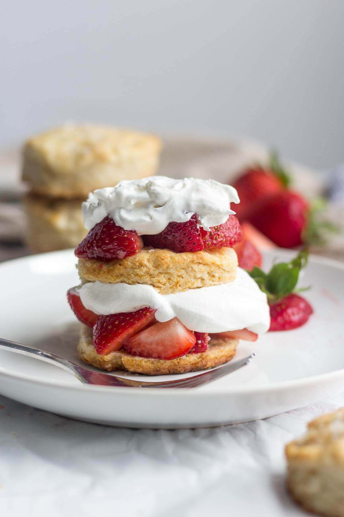 Healthy strawberry shortcake! Made with fresh fruit and real ingredients, this skinny strawberry shortcake is a guilt free dessert you can eat all summer long!