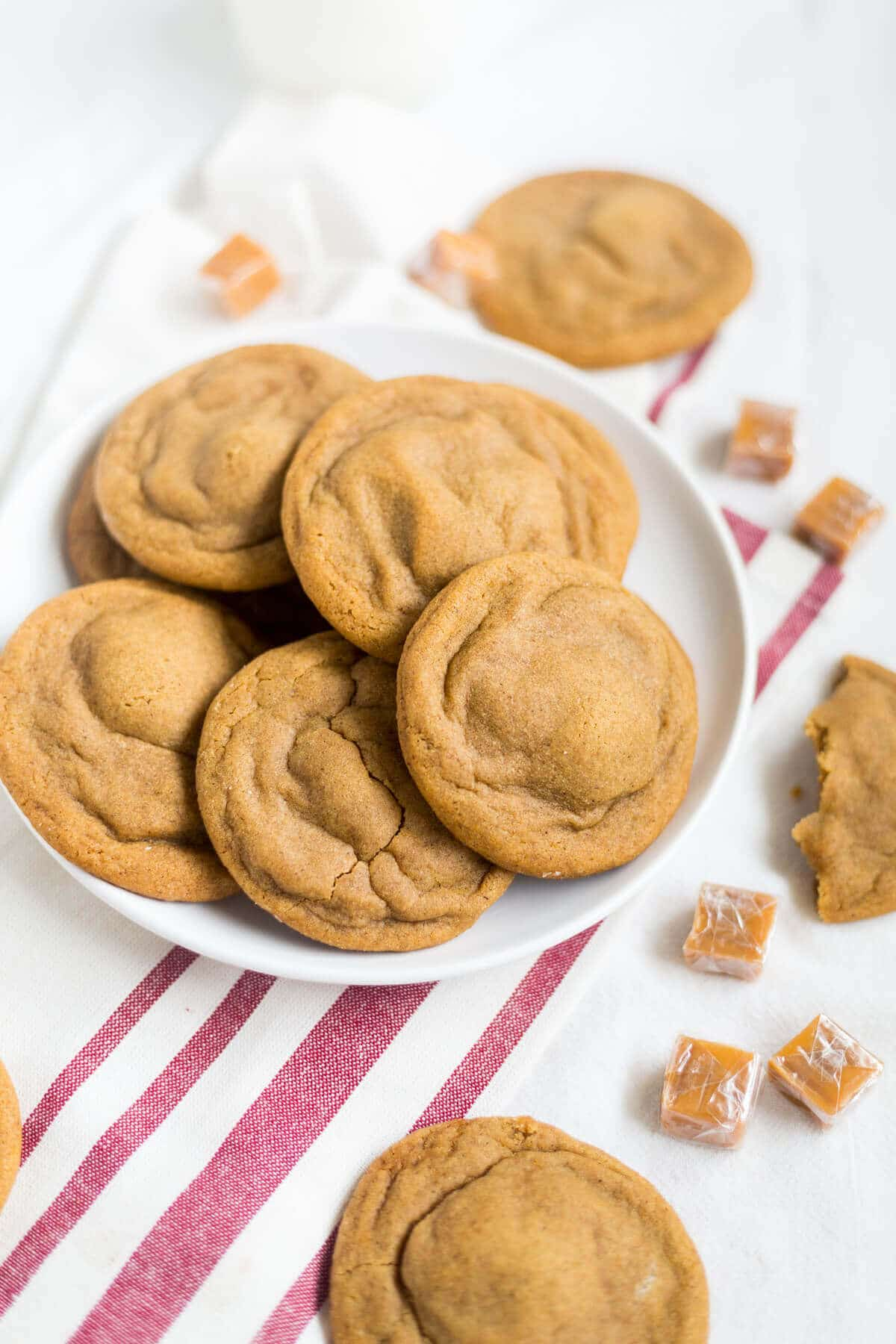 These soft and chewy ginger cookies are stuffed with a little salted caramel and baked to perfection. They're a great holiday recipe to add to your Christmas cookie collection.