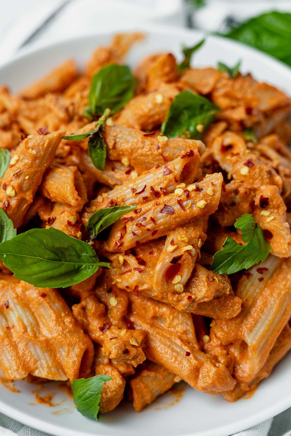 creamy penne arrabbiata with red pepper flakes and fresh basil