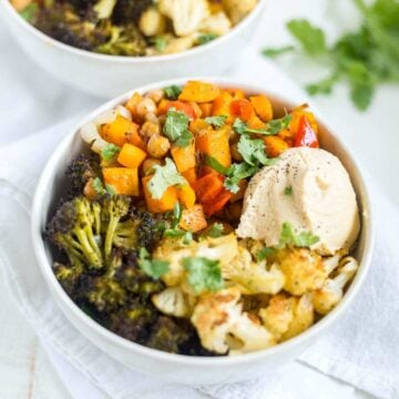 veggie quinoa power bowl with hummus in a white bowl for lunch
