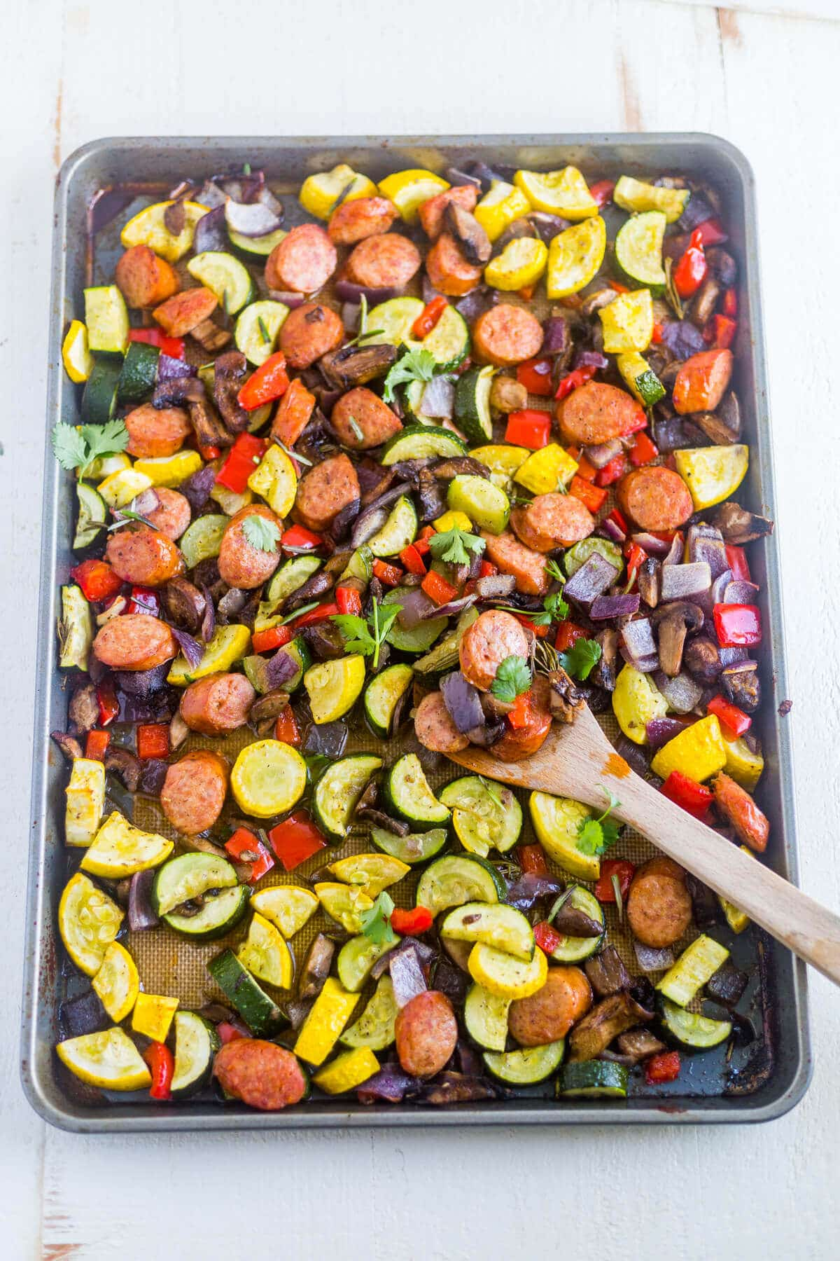 roasted sausage and veggies on a sheet pan
