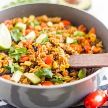 One pot taco pasta is a healthy and easy dinner recipe! Made with pasta, ground beef, tomatoes, black beans and brown rice pasta, this dinner is a simple and healthy meal for the family. It just so happens to be gluten free and dairy free too!