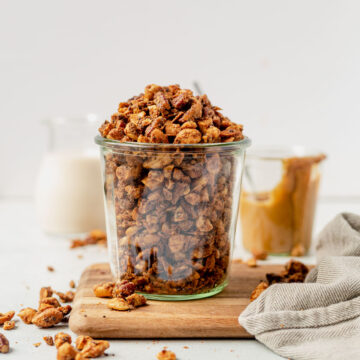 grain free granola overflowing out of a glass jar