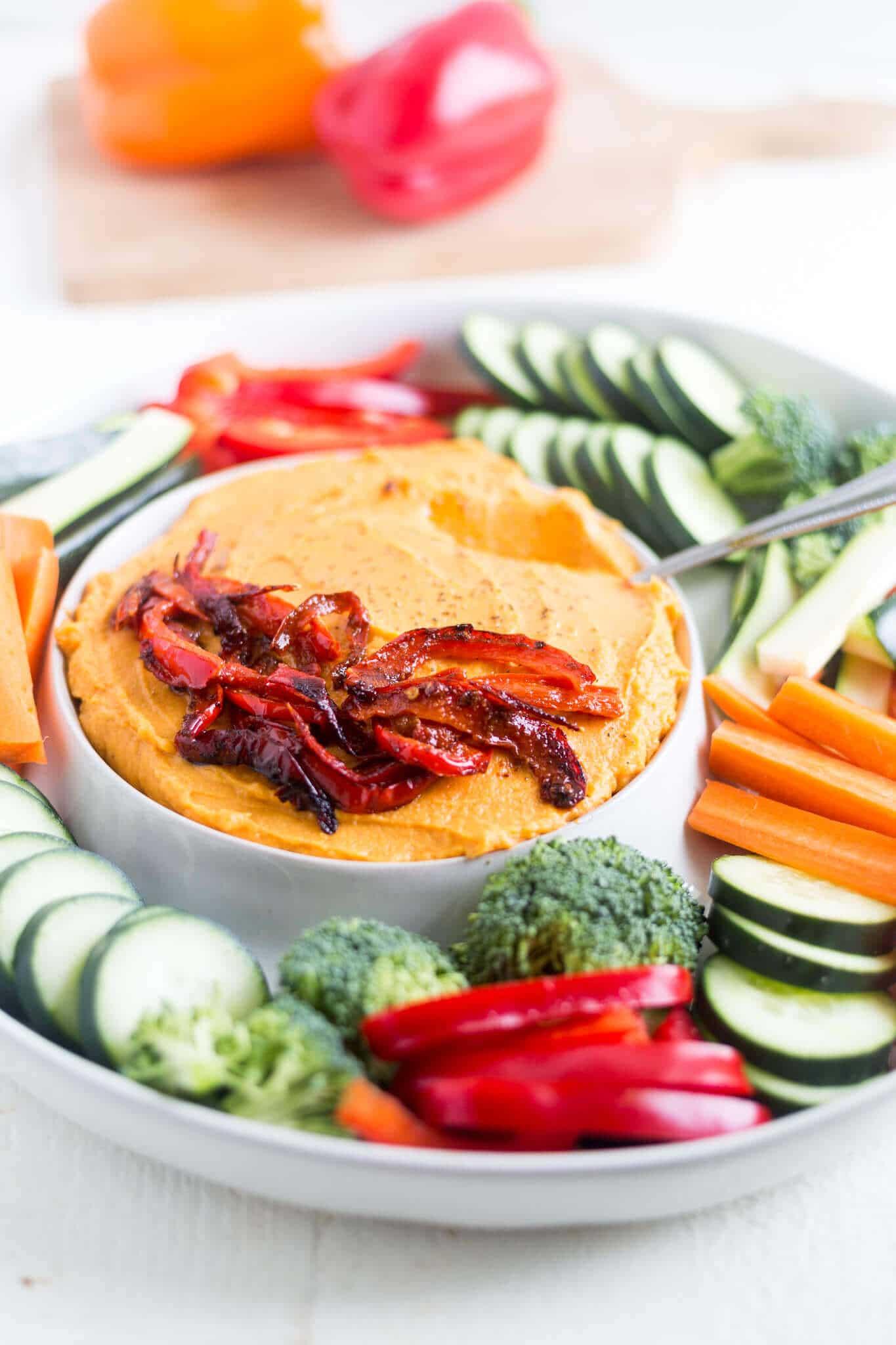 sweet potato hummus on a serving dish with fresh veggies