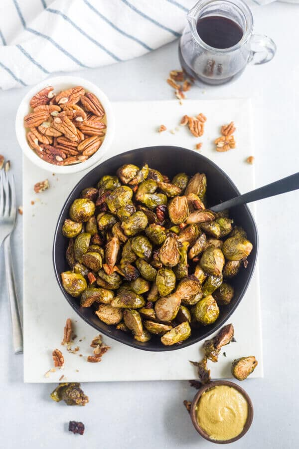 healthy anti inflammatory recipe for brussels sprouts in a black serving bowl