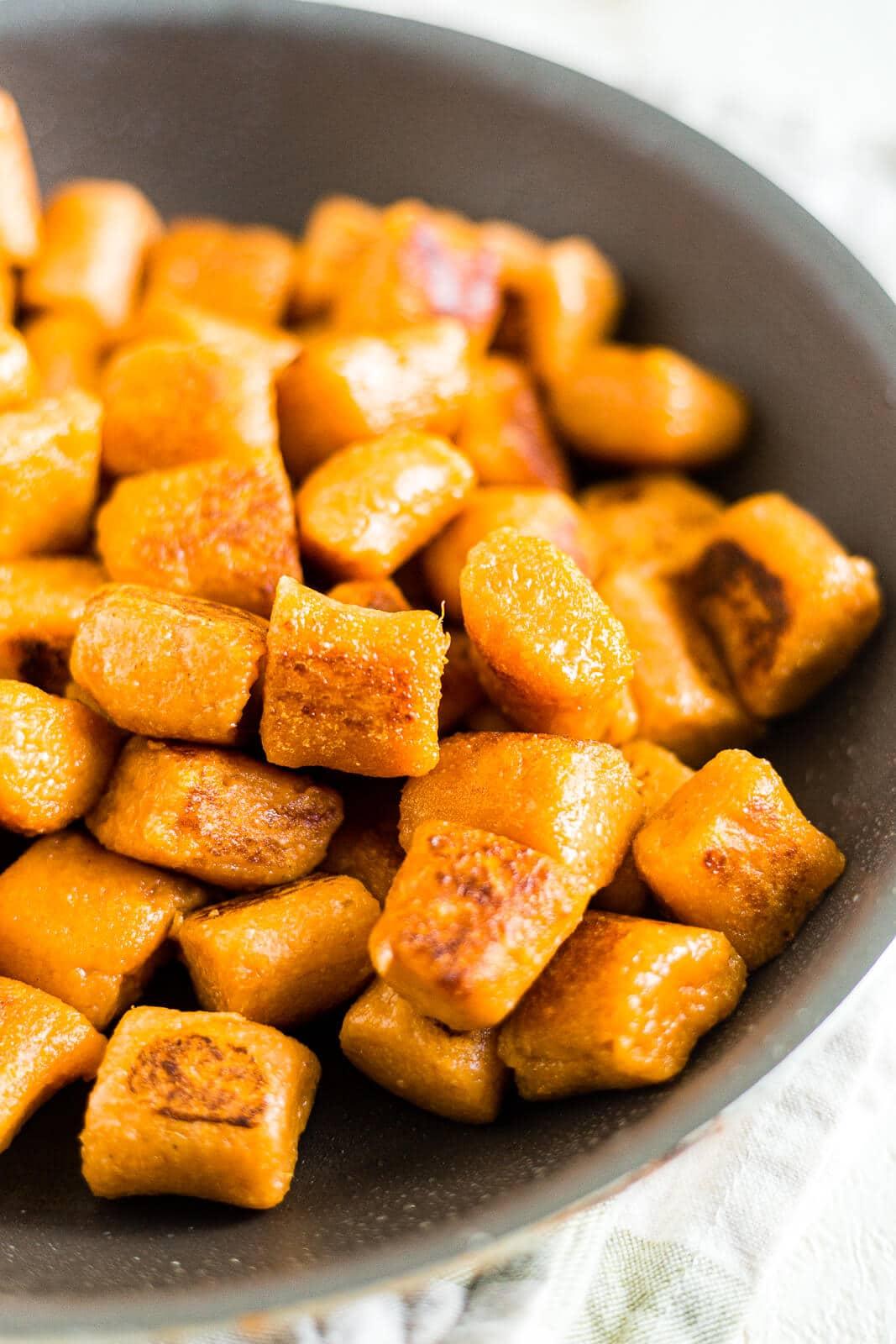boiled and seared sweet potato gnocchi recipe in a black saute pan