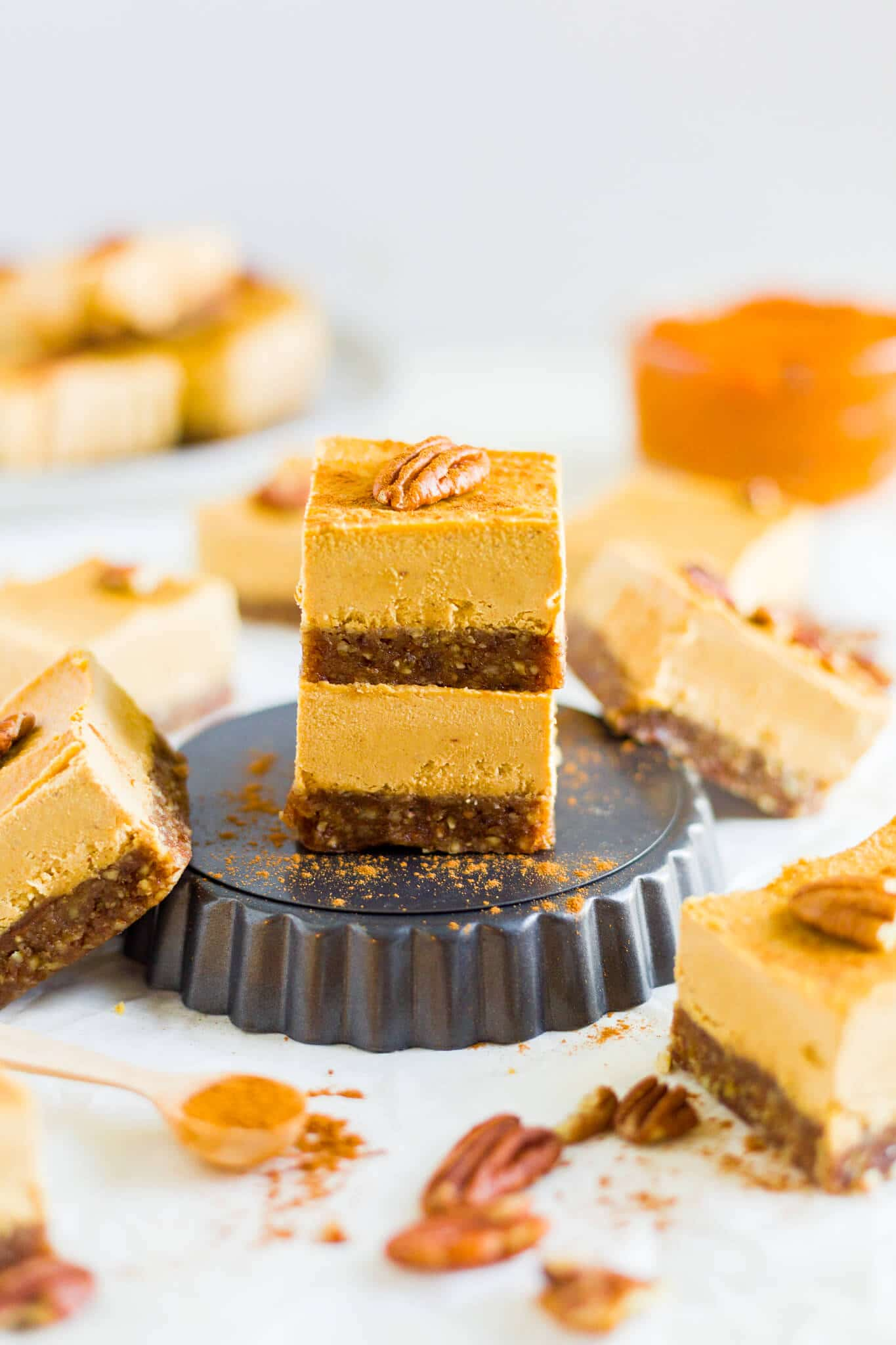 two pieces of vegan pumpkin cheesecake on a mini serving platter