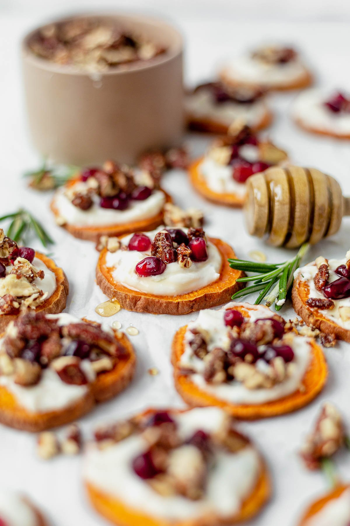 sweet potato bites topped with goat cheese, pecans and honey
