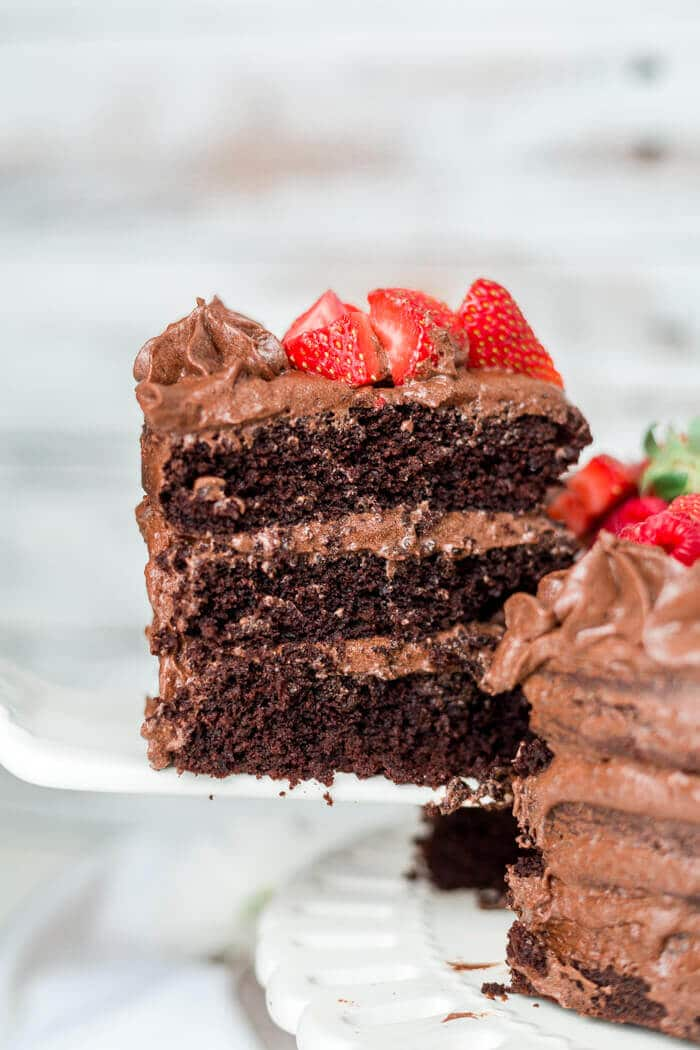 thick layers of paleo chocolate cake coated in a paleo buttercream