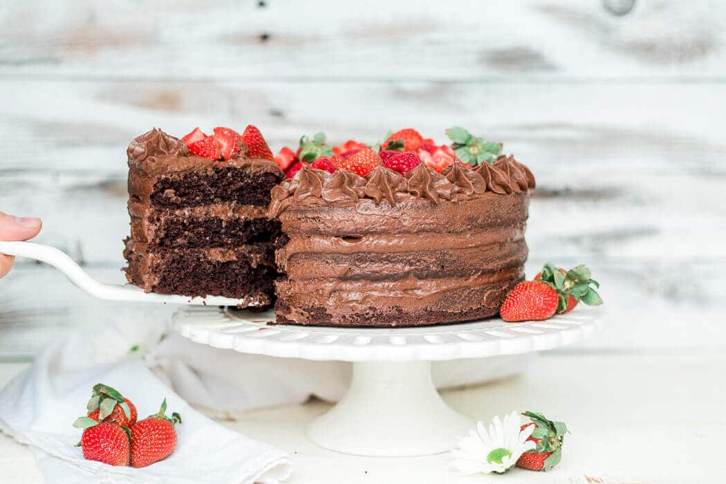 a slice of paleo chocolate cake being pulled out to serve