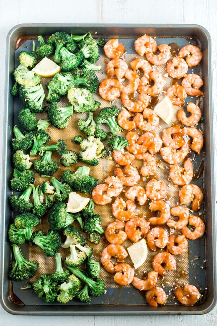 sheet pan with honey garlic shrimp, broccoli and lemon slices