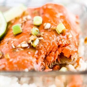 honey glazed salmon in a dish with a bite taken out