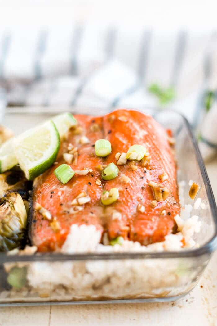 meal prep honey glazed salmon baked with white rice, brussels sprouts and green onion