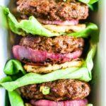 three hawaiian teriyaki burgers stacked with lettuce