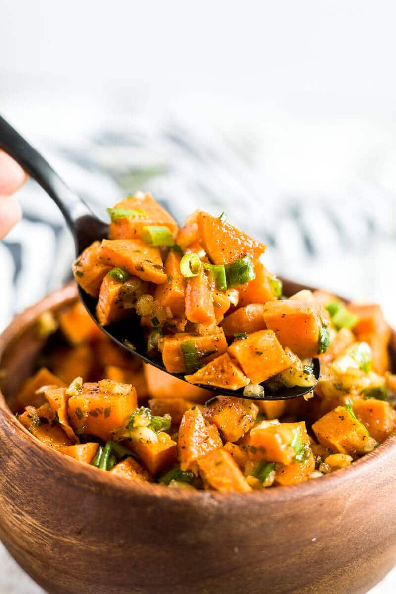spoon scooping sweet potato salad out of a bowl