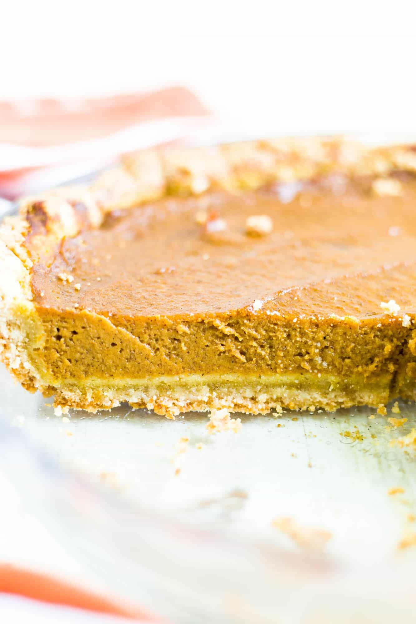 dairy free pumpkin pie recipe slice in the pie dish