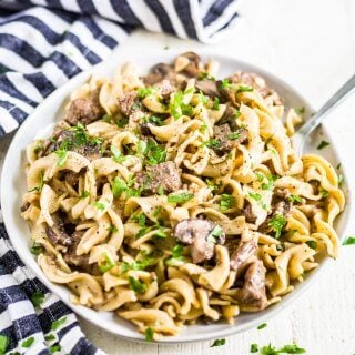 instant pot beef stroganoff on a plate with a fork
