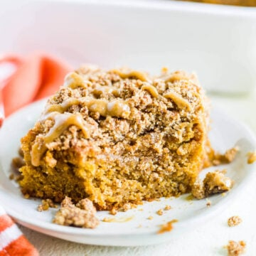 pumpkin coffee cake on a plate with a bite taken out