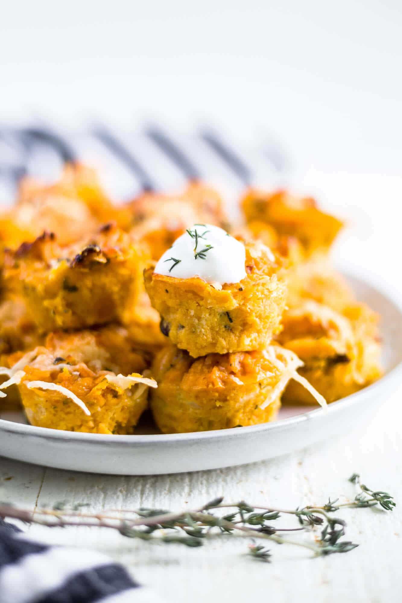sweet potato puffs on a white serving plate