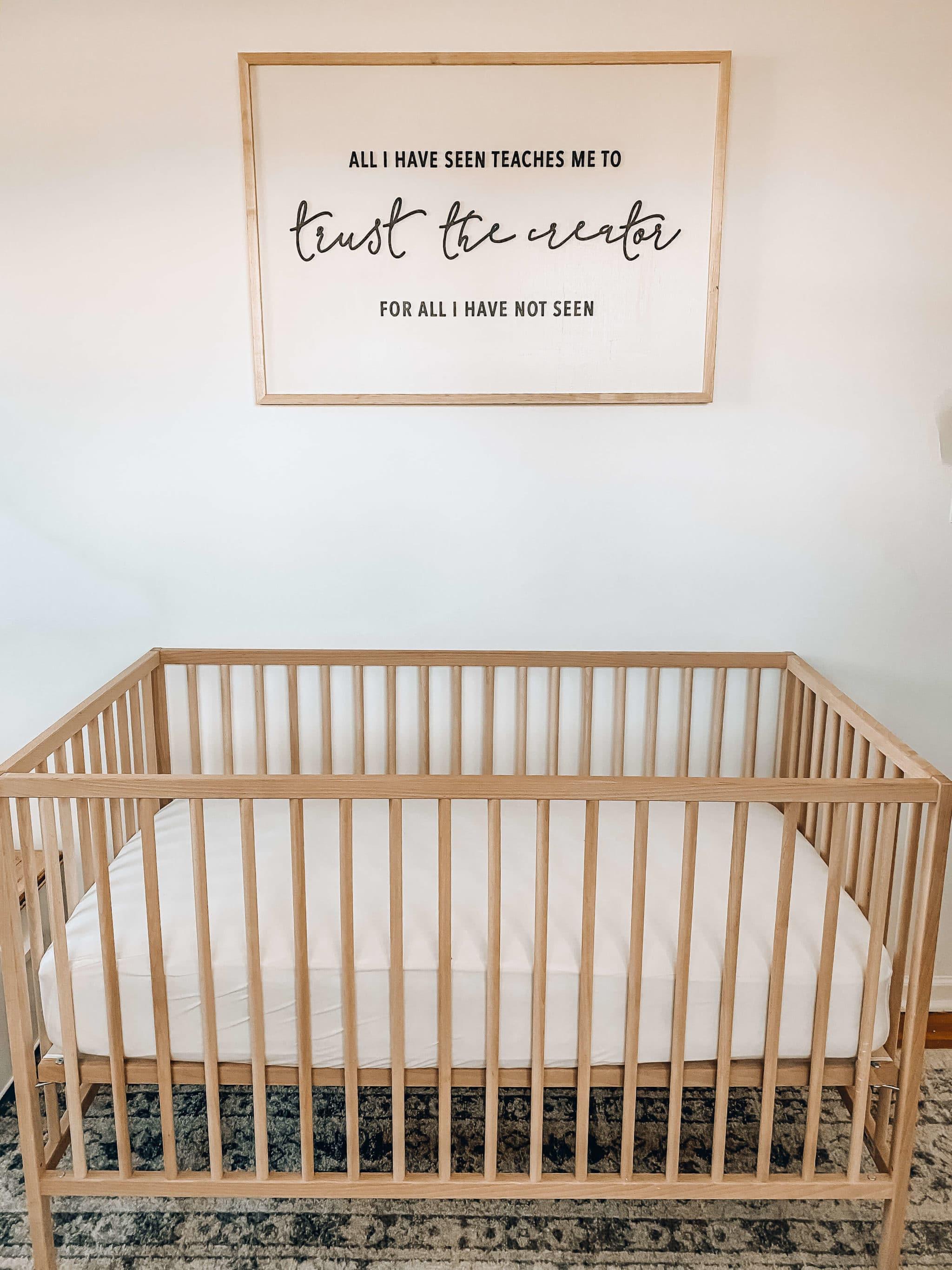 neutral white nursery crib