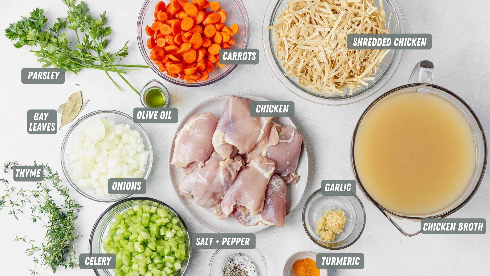 instant pot chicken noodle soup ingredients spread out on a table