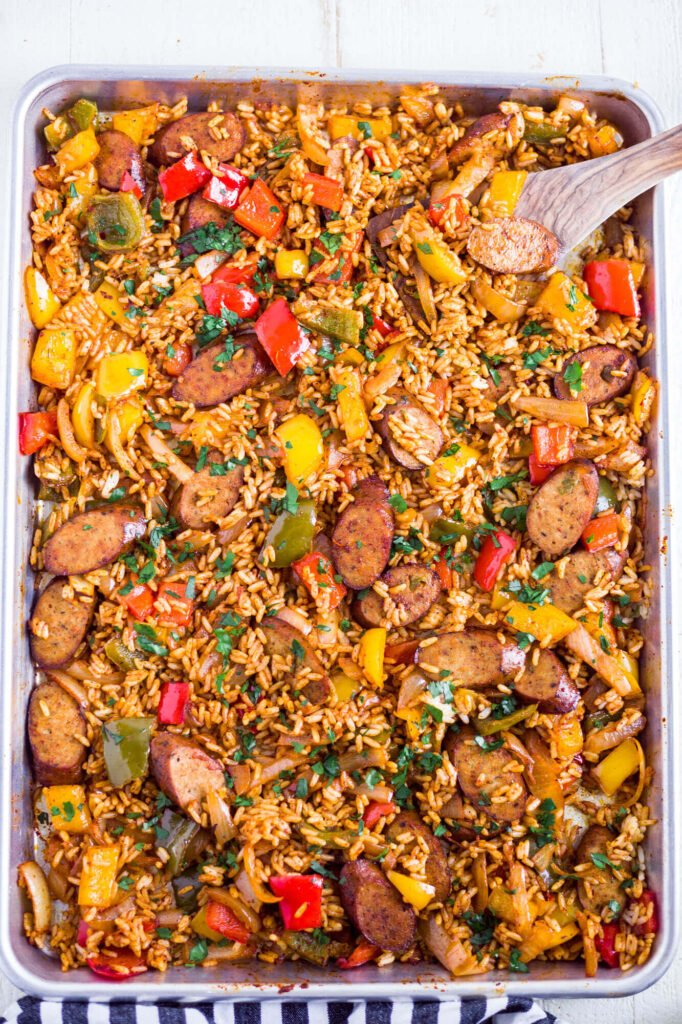 rice, veggies and chicken on a sheet pan for a sheet pan burrito bowl recipe