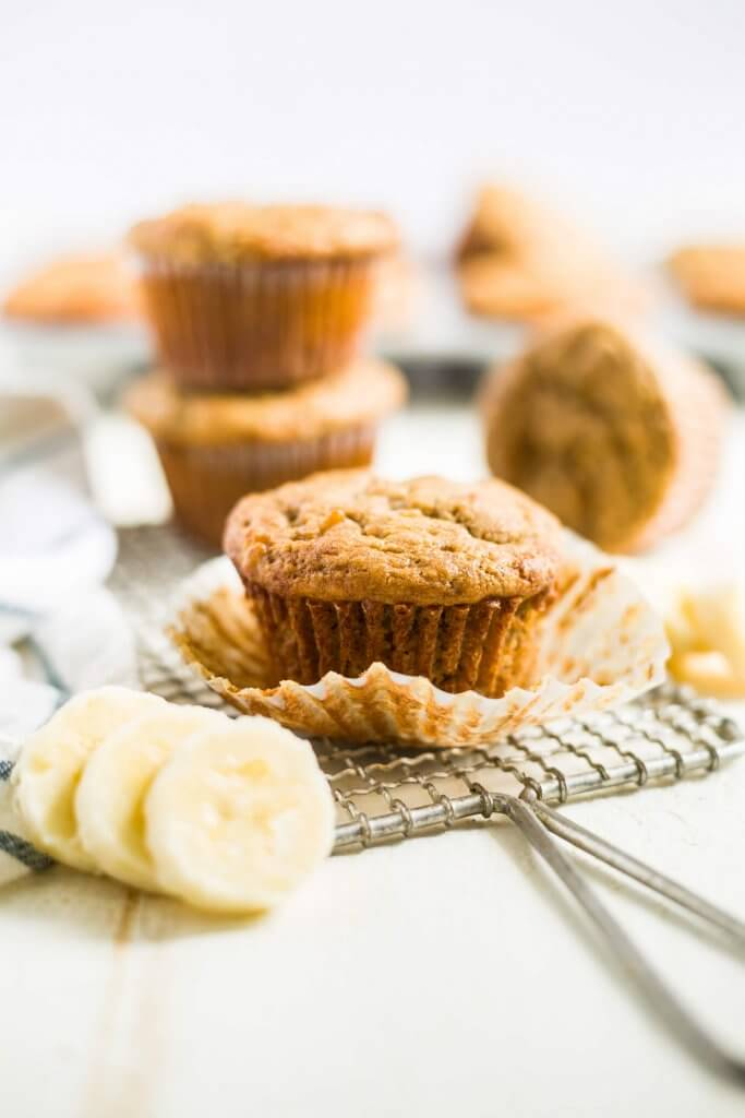 healthy banana muffin unwrapped on a cooling wrack