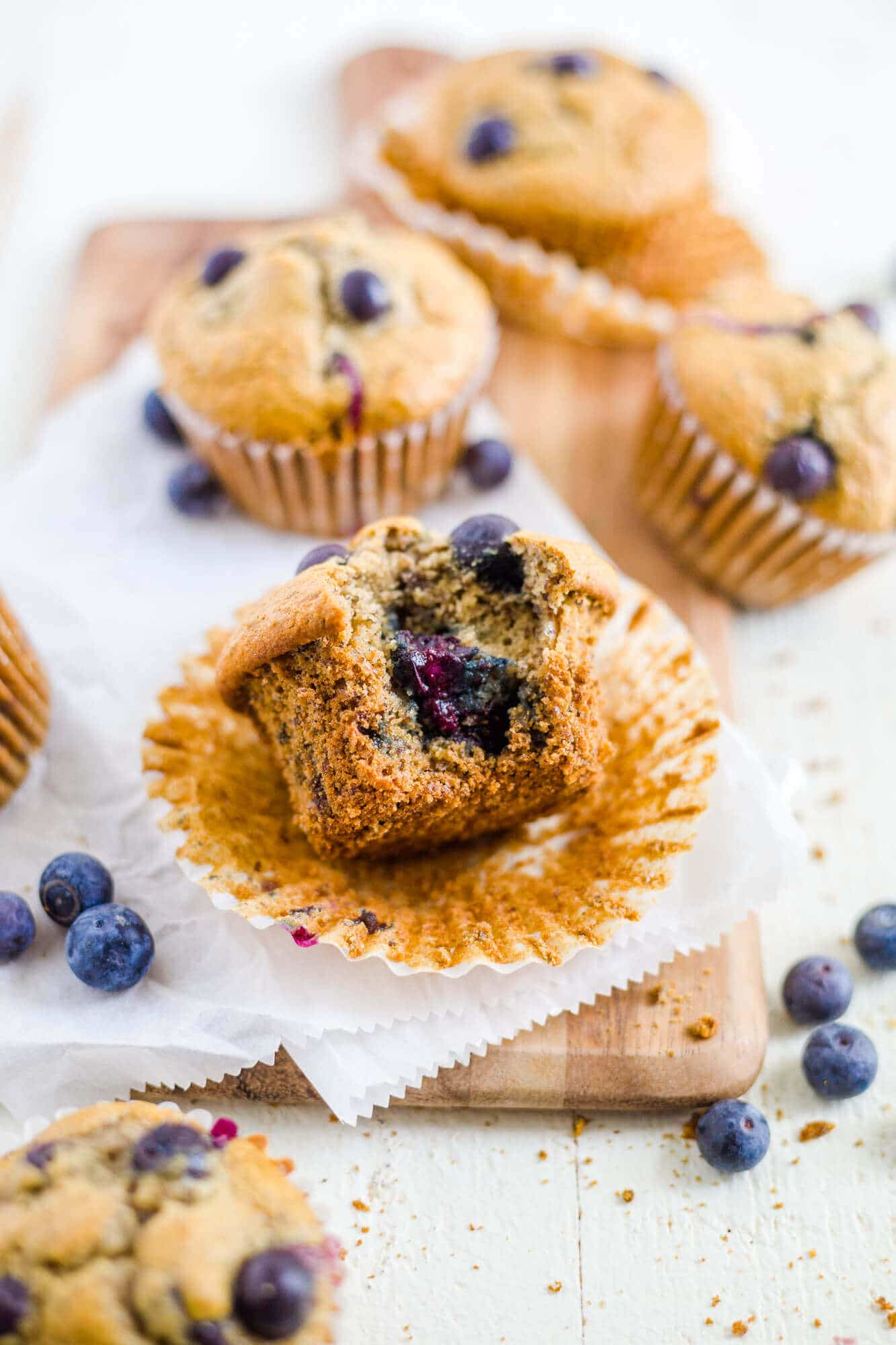 blueberry lactation muffin on the table with a bite taken out of it