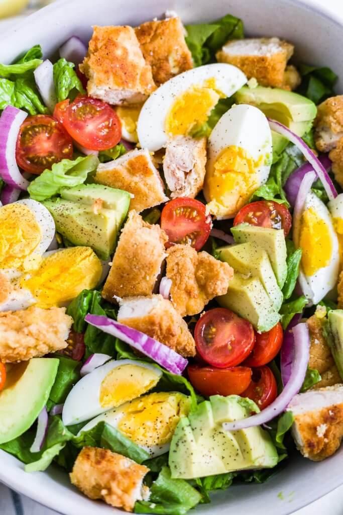 crispy chicken salad in a white bowl