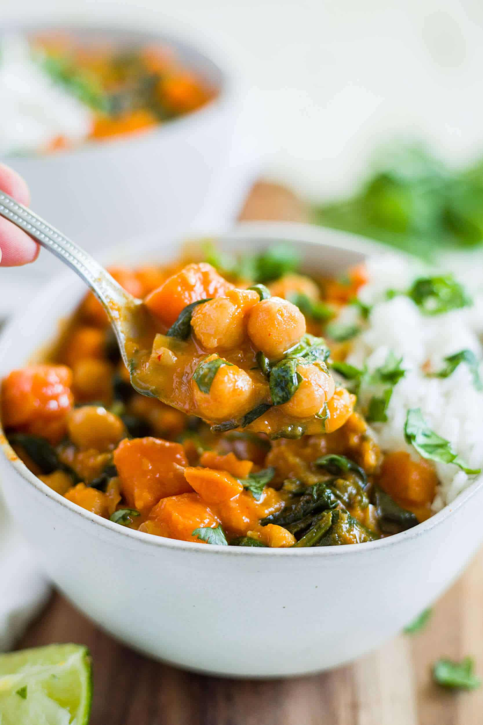 a bowl of creamy sweet potato curry and rice with a spoon