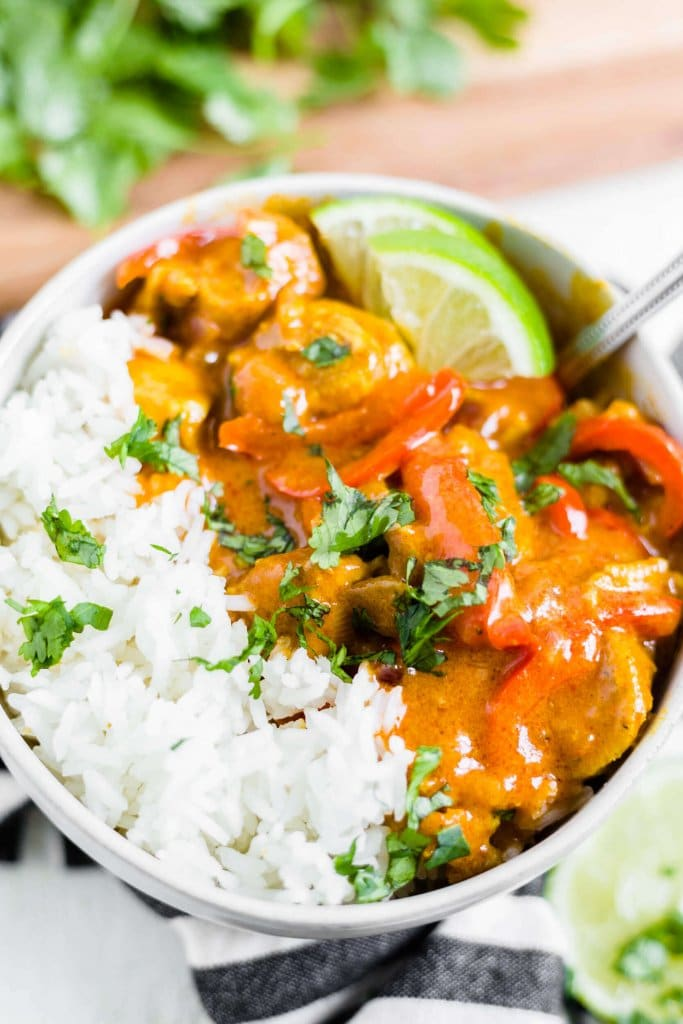 coconut curry chicken with white rice in a bowl