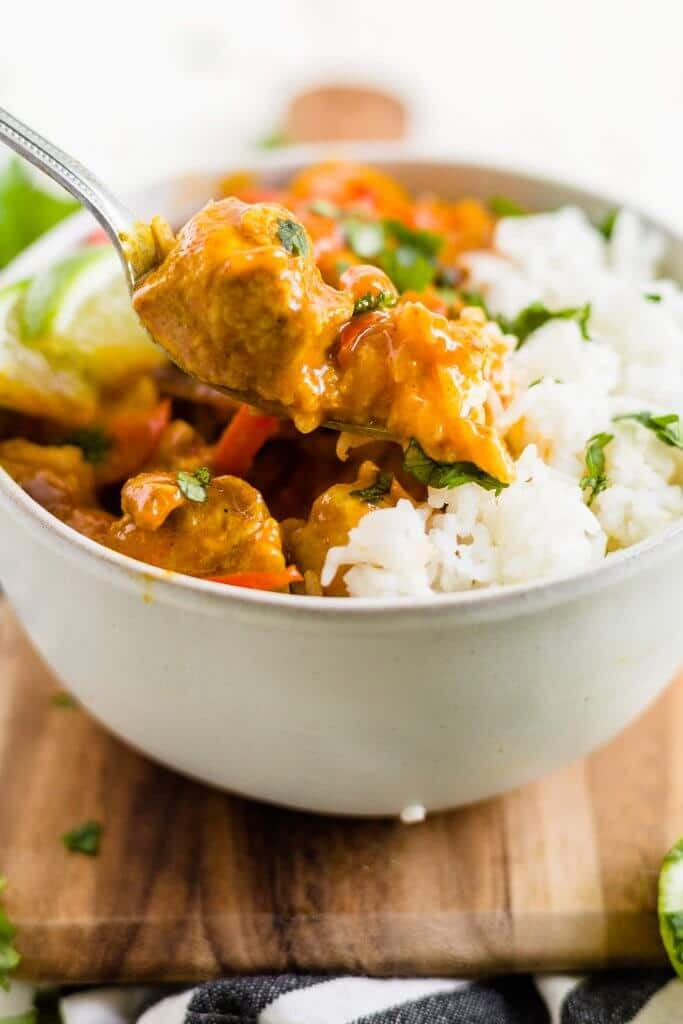spoon scooping out coconut curry chicken recipe
