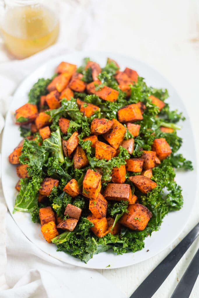 roasted chipotle sweet potato salad on a white plate
