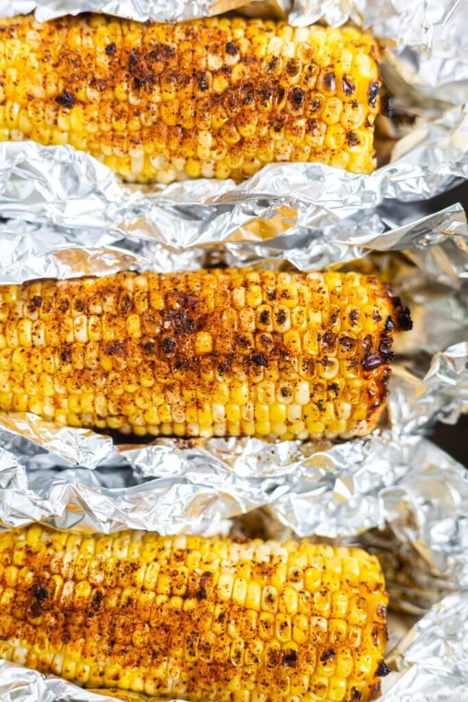 roasted corn with spices in foil