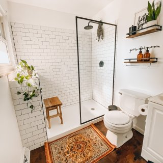 modern farmhouse bathroom update reveal with wood floors, walk in shower and open shelves