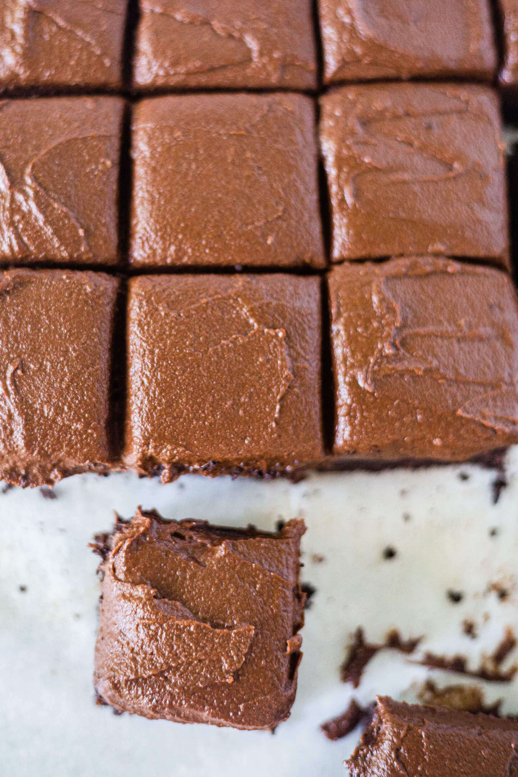 square slices of frosted gluten free sweet potato chocolate cake