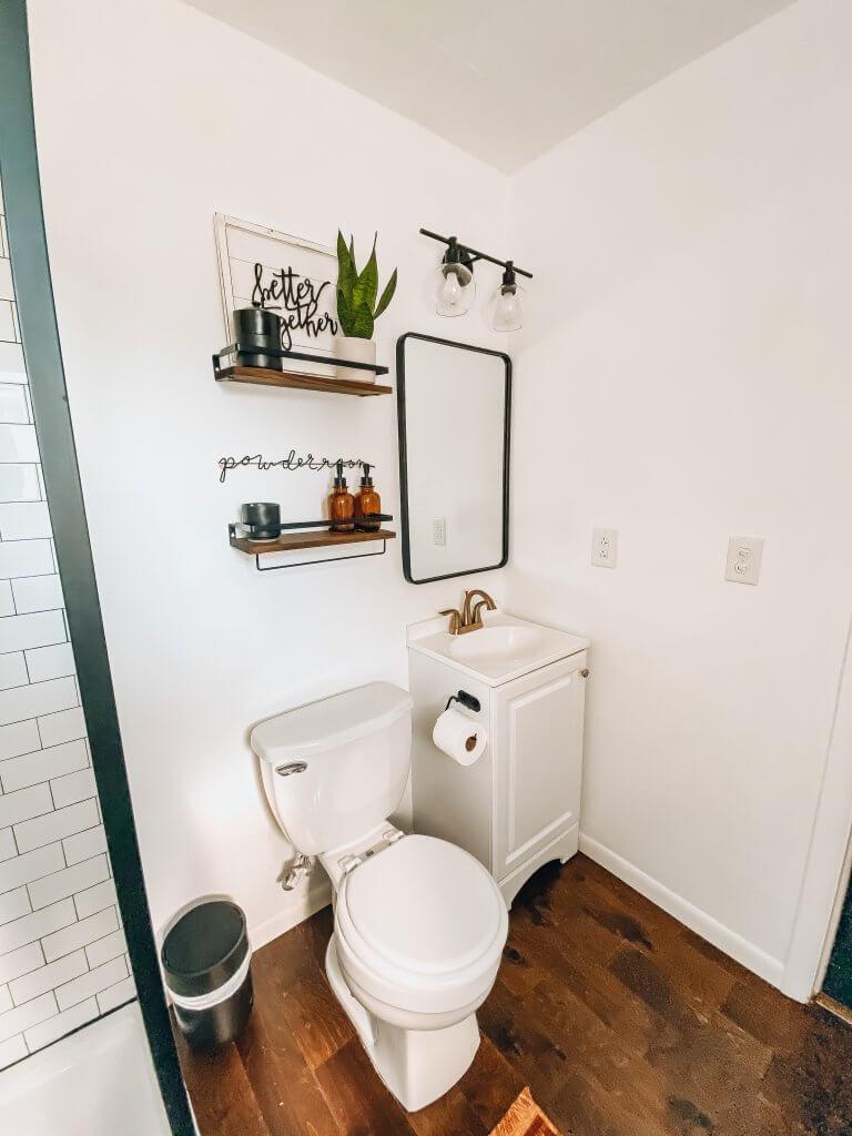 modern farmhouse bathroom decor above sink with mirror and lighting