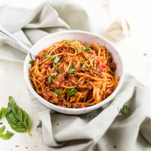 instant pot spaghetti is such an easy healthy pasta recipe and this recipe with meat sauce is topped with fresh basil