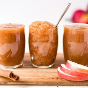 homemade crockpot applesauce in a jar with a spoon