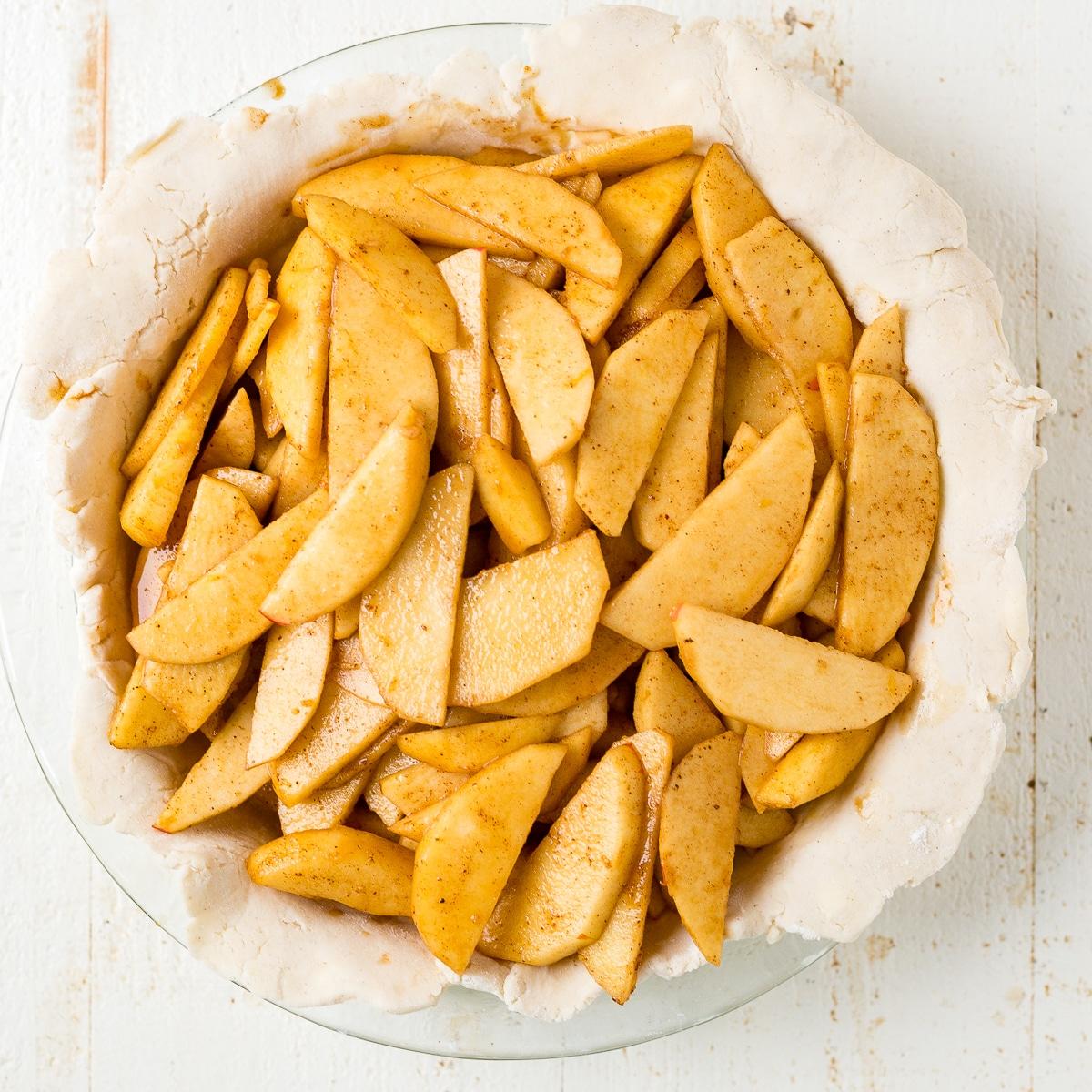 gluten free apple pie filling in the crust before baking