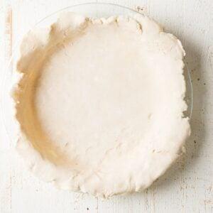 gluten free pie crust inside the glass baking dish