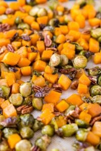 roasted brussel sprouts and squash on a sheet pan